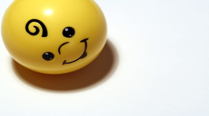 Happy face yellow ball