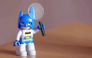 Batman with a magnifying glass