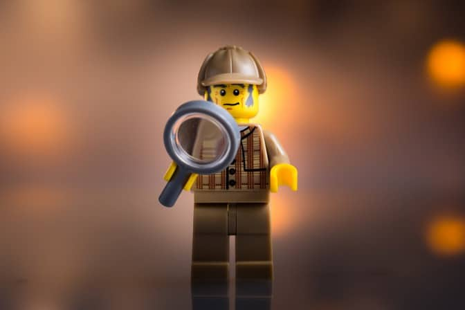 Lego man investigating why people change ITSM tool.