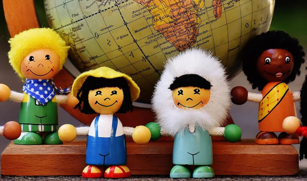 Little people around a globe depicting multi-language