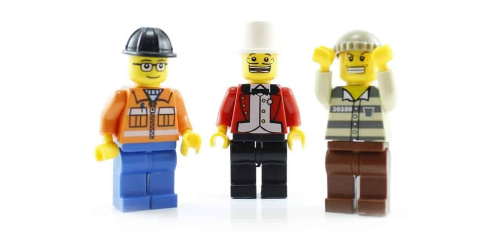 Three lego people in a line